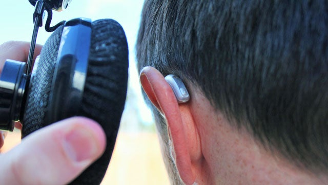 Receiver-in-canal hearing aid with over-ear headphones.