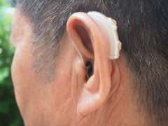 RIC hearing aid in use