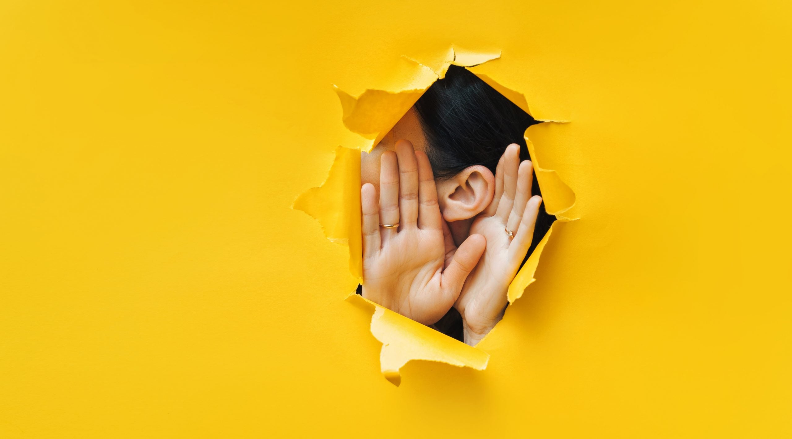 female experiencing muffled hearing