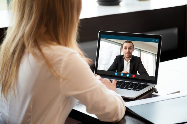 Woman attending a virtual meeting from home